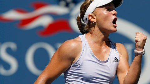 FILE - In this Sept. 2, 2009, file photo, Melanie Oudin, of the United States, reacts during her match against Elena Dementieva, of Russia, in the second round of the U.S. Open tennis tournament in New York. Oudin, a surprise 2009 U.S. Open quarterfinalist, says in a series of posts on Twitter on Friday, Aug. 18, 2017, that she is retiring from tennis at age 25.  (AP Photo/Kathy Willens, File)