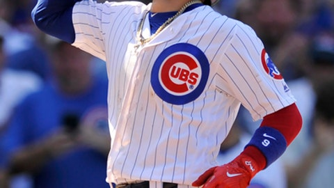 Chicago Cubs' Javier Baez celebrates at home plate after hitting a two-run home run during the eighth inning of a baseball game against the Toronto Blue Jays, Friday, Aug. 18, 2017, in Chicago. (AP Photo/Paul Beaty)