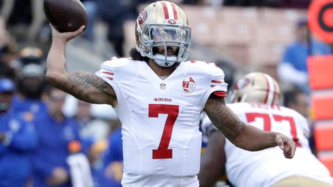 FILE - In this Dec. 24, 2016, file photo, San Francisco 49ers quarterback Colin Kaepernick prepares to throw during the first half of an NFL football game against the Los Angeles Rams in Los Angeles. Maybe if we had just followed the lead of Kaepernick, who had hoped the simple act of taking a knee during a song _ OK, the national anthem _ would make us all more aware and understanding of some of the serious problems plaguing this country. (AP Photo/Rick Scuteri, File)