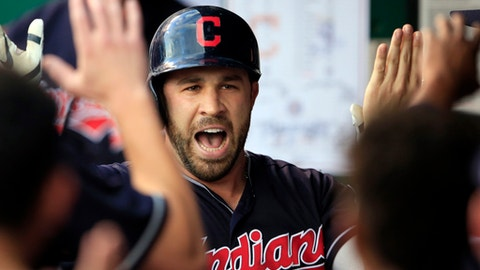Cleveland Indians' Jason Kipnis celebrates his solo home run with teammates during the first inning of a baseball game against the Kansas City Royals at Kauffman Stadium in Kansas City, Mo., Friday, Aug. 18, 2017. (AP Photo/Orlin Wagner)