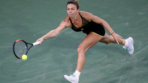 Simona Halep, of Romania, returns to Johanna Konta, of Britain, at the Western & Southern Open tennis tournament Friday, Aug. 18, 2017, in Mason, Ohio. (AP Photo/John Minchillo)