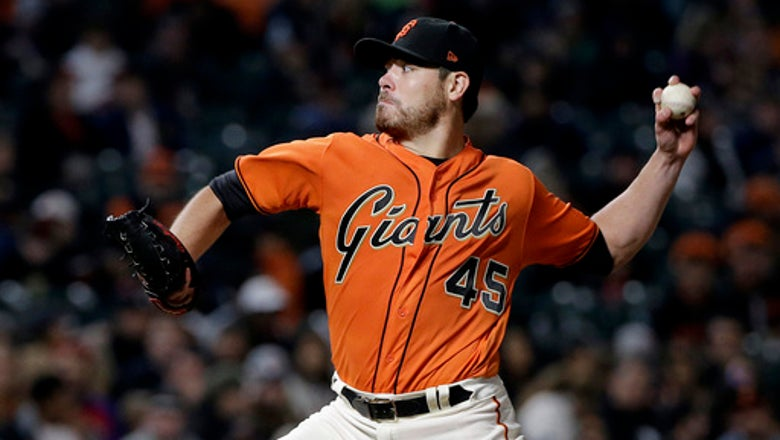 Moore pitches into 8th, Giants beat Phillies 10-2