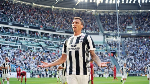 Juventus' Mario Mandzukic celebrates after scoring during a Serie A soccer match between Juventus and Cagliari, in Turin, Italy, Saturday, Aug. 19, 2017. (Alessandro Di Marco/ANSA via AP)