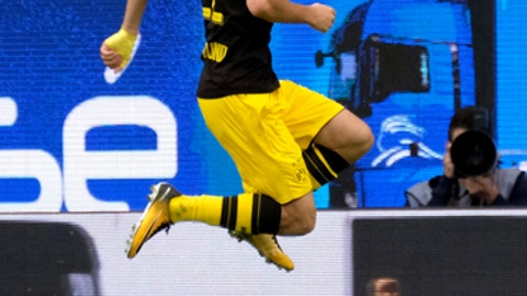 Dortmund's Christian Pulisic celebrates scoring the first goal of the game against Wolfsburg, during the German Bundesliga soccer match between VfL Wolfsburg and Borussia Dortmund in the Volkswagen Arena in Wolfsburg, Germany, Saturday Aug. 19, 2017. (Peter Steffen/dpa via AP)