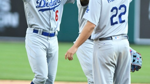 Los Angeles Dodgers outfielders Curtis Granderson, left, and Yasiel Puig, center, high five pitcher Clayton Kershaw following the Dodgers' 3-0 win over the Detroit Tigers in a baseball game, Saturday, Aug. 19, 2017, in Detroit. (AP Photo/Lon Horwedel)