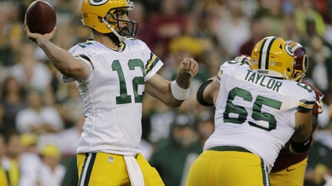 Green Bay Packers quarterback Aaron Rodgers (12) passes the ball during the first half of an NFL preseason football game against the Washington Redskins in Landover, Md., Saturday, Aug. 19, 2017. (AP Photo/Mark Tenally)