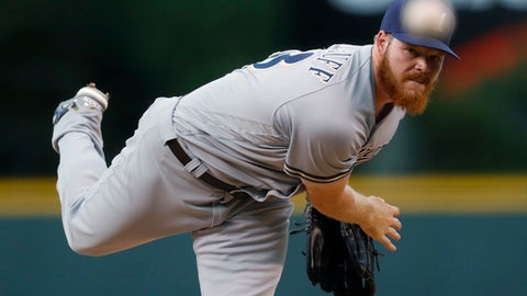 Milwaukee Brewers starting pitcher Brandon Woodruff delivers to Colorado Rockies' Charlie Blackmon in the first inning of a baseball game Saturday, Aug. 19, 2017, in Denver. (AP Photo/David Zalubowski)