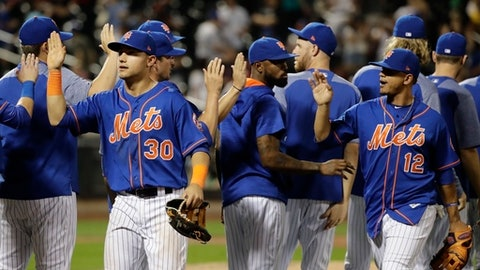 New York Mets' Michael Conforto (30) and Juan Lagares (12) celebrate with teammates after a baseball game against the Miami Marlins Saturday, Aug. 19, 2017, in New York. The Mets won 8-1. (AP Photo/Frank Franklin II)