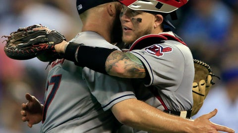 Cleveland Indians relief pitcher Cody Allen, left, is congratulated by catcher Roberto Perez, right, following a baseball game against the Kansas City Royals at Kauffman Stadium in Kansas City, Mo., Saturday, Aug. 19, 2017. The Indians defeated the Royals 5-0. (AP Photo/Orlin Wagner)