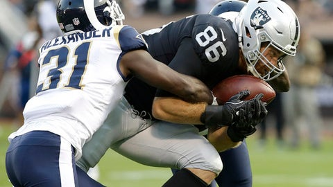 Oakland Raiders tight end Lee Smith (86) catches a touchdown pass against Los Angeles Rams free safety Maurice Alexander (31) during the first half of an NFL preseason football game in Oakland, Saturday, Aug. 19, 2017. (AP Photo/Rich Pedroncelli)