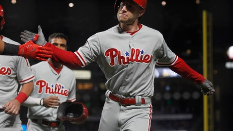 Philadelphia Phillies' Ty Kelly celebrates his sixth-inning grand slam during a baseball game against the San Francisco Giants, Saturday, Aug. 19, 2017, in San Francisco. (AP Photo/Mathew Sumner)