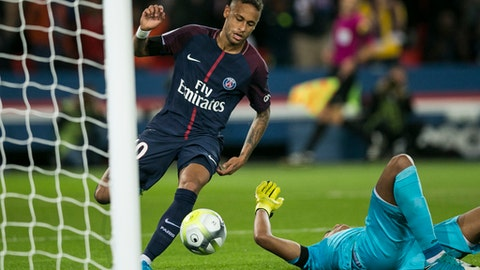 PSG's Neymar scores against Toulouse during the French League One soccer match between PSG and Toulouse at the Parc des Princes stadium in Paris, France, Sunday, Aug. 20, 2017. (AP Photo/Kamil Zihnioglu)