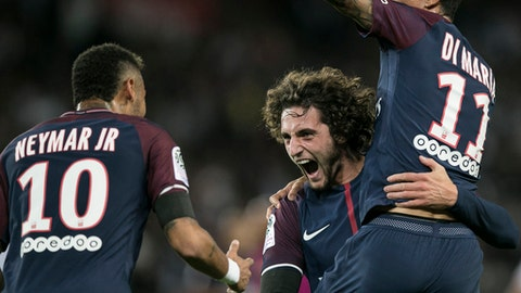 PSG's Adrien Rabiot, center, PSG's Angel Di Maria smile to PSG's Neymar, left, after scoring during the French League One soccer match between PSG and Toulouse at the Parc des Princes stadium in Paris, France, Sunday, Aug. 20, 2017. (AP Photo/Kamil Zihnioglu)