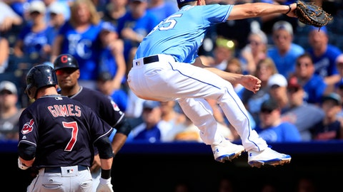 Cleveland Indians' Yan Gomes (7) reaches first base on an errant throw to Kansas City Royals first baseman Eric Hosmer (35) during the seventh inning of a baseball game at Kauffman Stadium in Kansas City, Mo., Sunday, Aug. 20, 2017. Royals third baseman Cheslor Cuthbert received the error. (AP Photo/Orlin Wagner)