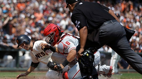 Philadelphia Phillies catcher Jorge Alfaro (38) tags out San Francisco Giants' Buster Posey in the third inning of a baseball game, Sunday, Aug. 20, 2017, in San Francisco. Posey tried to score on a single by Giants' Brandon Crawford. At right is home plate umpire Adrian Johnson. (AP Photo/Ben Margot)
