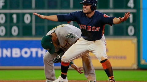 Houston Astros' Jose Altuve gestures as he safely steals second base ahead of the throw to Oakland Athletics shortstop Marcus Semien in the eighth inning of a baseball game, Sunday, Aug. 20, 2017, in Houston. (AP Photo/Richard Carson)