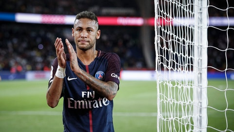 PSG's Neymar applauds with supporters after the French League One soccer match between PSG and Toulouse at the Parc des Princes stadium in Paris, France, Sunday, Aug. 20, 2017. (AP Photo/Kamil Zihnioglu)