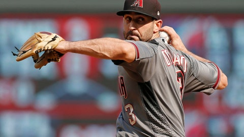 Arizona Diamondbacks infielder Daniel Descalso pitches in relief against the Minnesota Twins in the eighth inning of a baseball game, Sunday, Aug. 20, 2017, in Minneapolis. The Twins won 12-5. (AP Photo/Jim Mone)
