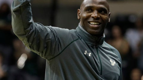 File- This Dec. 17, 2016, file photo shows South Florida head football coach Charlie Strong waving to the crowd after being introduced during the first half of an NCAA college basketball game in Tampa, Fla. Twenty years after launching its football program from scratch, South Florida could be on the verge of realizing its vast potential. The Bulls open the season ranked in the Top 25 and coach Charlie Strong has been brought in to help them meet their high expectations.(AP Photo/Chris O'Meara, File)