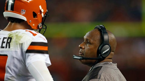 Cleveland Browns head coach Hue Jackson, right, talks with quarterback Brock Osweiler in the first half of an NFL preseason football game against the New York Giants, Monday, Aug. 21, 2017, in Cleveland. (AP Photo/Ron Schwane)