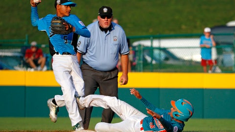 Maracaibo, Venezuela's Dario Cardozo (16) slides into Santiago, Dominican Republic second baseman Erick Torres (5) after being forced out on a fielder's choice in the second inning of an International elimination baseball game at the Little League World Series tournament in South Williamsport, Pa., Monday, Aug. 21, 2017. Umpire Christopher Ruiz ruled Cardozo out for sliding with his spikes high. (AP Photo/Gene J. Puskar)