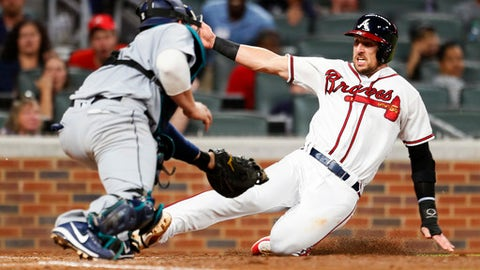 Atlanta Braves Matt Adams (18) is tagged out at home by Seattle Mariners catcher Mike Zunino (3) in the sixth inning of a baseball game, Monday, Aug. 21, 2017, in Atlanta. (AP Photo/Todd Kirkland)