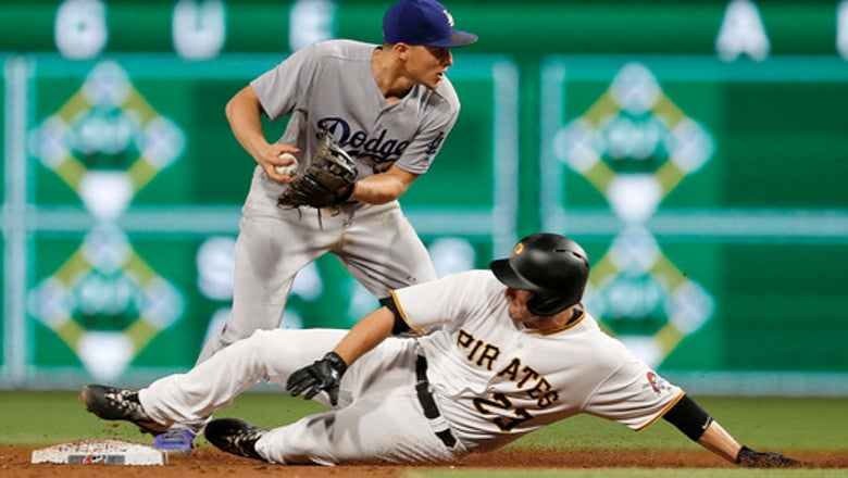 Puig homers, Dodgers beat Pirates 6-5 in 12 innings