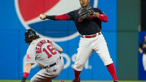 Cleveland Indians' Jose Ramirez forces Boston Red Sox' Andrew Benintendi out at second and throws to first to complete a double play in the seventh inning of a baseball game in Cleveland, Monday Aug. 21, 2017. (AP Photo/Phil Long)
