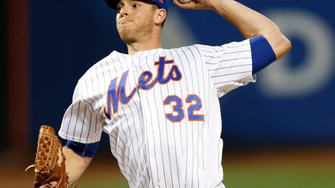 FILE - In this Sunday, Aug. 6, 2017 file photo, New York Mets starting pitcher Steven Matz winds up during the first inning of a baseball game against the Los Angeles Dodgers in New York. Mets pitcher Steven Matz needs another elbow operation, almost certainly ending a miserable season for the New York left-hander.  Matz was diagnosed Monday, Aug. 21, 2017 with irritation of the ulnar nerve in his left elbow, the team said. (AP Photo/Kathy Willens, File)