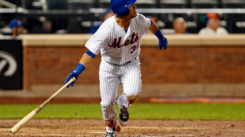 New York Mets' Michael Conforto watches a solo home run during the 10th inning of a baseball game against the Arizona Diamondbacks on Monday, Aug. 21, 2017, in New York. The Diamondbacks defeated the Mets 3-2. (AP Photo/Adam Hunger)