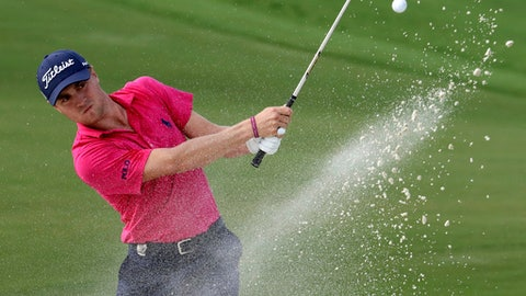 File-This Aug. 13, 2017, file photo shows Justin Thomas hitting from the bunker on the 18th hole during the final round of the PGA Championship golf tournament at the Quail Hollow Club in Charlotte, N.C. The FedEx Cup isn't the only trophy at stake over the next five weeks. One trophy is known for its $10 million prize, with $9 million in cash. The other is about respect and honor from the other players. (AP Photo/John Bazemore, File)