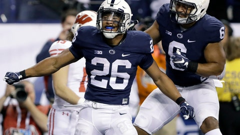 FILE - In this Saturday, Dec. 3, 2016, file photo, Penn State's Saquon Barkley (26) is congratulated by teammate Andre Robinson after catching an 18-yard pass for a touchdown during the second half of the Big Ten championship NCAA college football game against Wisconsin, in Indianapolis. A case can be made that Penn State's Barkley is both the best and strongest running back in college football. Coming off a sophomore season in which he ran for 1,496 yards and scored 22 touchdowns, Barkley was overwhelmingly selected to the AP's preseason All-America team. (AP Photo/Michael Conroy, File)