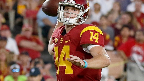 FILE - In this Oct. 1, 2016, file photo, Southern California quarterback Sam Darnold (14) throws a touchdown pass to wide receiver JuJu Smith-Schuster (9) during the first half of an NCAA college football game in Los Angeles. Darnold and Penn State Saquon Barkley put on a show at the Rose Bowl to end last season, and established themselves as two of the biggest stars in college football coming into 2017. Now the two Heisman Trophy contenders highlight The Associated Press preseason All-America team released Tuesday. (AP Photo/Ryan Kang, File)