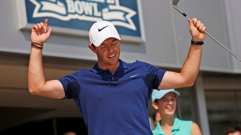 Rory McIlroy reacts while hiting some golf balls in Yankee Stadium in New York, Tuesday, Aug. 22, 2017. McIlroy was there to be part of a donation by FedEx to St. Jude Children's Research Hospital. McIlroy is the defending FedEx Cup champion and is planning to play the first leg of the tournament in Old Westbury, N.Y., starting on Thursday. (AP Photo/Seth Wenig)