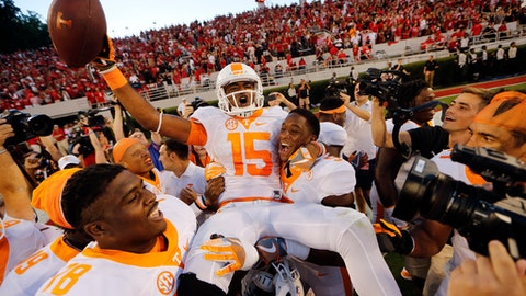 FILE -- In this Oct. 1, 2016 file photo, Tennessee wide receiver Jauan Jennings (15) is carried by teammates Kyle Phillips (5) and Charles Mosley (78) after making a last-second touchdown catch to defeat Georgia 34-31 in an NCAA college football game in Athens, Ga. Jennings must develop into a consistently reliable No. 1 target as one of the few returning playmakers on the 25th-ranked Volunteers' offense. (AP Photo/John Bazemore, File)