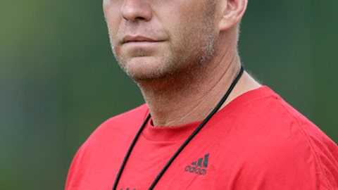 In this photo taken Saturday, July 29, 2017, North Carolina State coach Dave Doeren looks on during the team's NCAA college football practice in Raleigh, N.C. Doeren has dismissed two players from the team and suspended three others for violating athletics department and team rules tied to marijuana and alcohol during a campus party last month. The team announced those dismissals and suspensions Tuesday, Aug. 22, 2017, while the school issued a news release saying the violations were discovered as university police investigated allegations of sexual assault. (AP Photo/Gerry Broome, File)