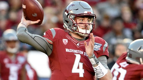 File-This Dec. 27, 2016, file photo shows  Washington State quarterback Luke Falk (4) passing during the first half of the Holiday Bowl NCAA college football game in San Diego. Falk arrived at Washington State as a walk-on and mostly unknown. He's about to begin his senior season for the 24th-ranked Cougars with a chance to rewrite the Pac-12 record book as the latest in a lineage of star quarterbacks on the Palouse. (AP Photo/Denis Poroy, File)