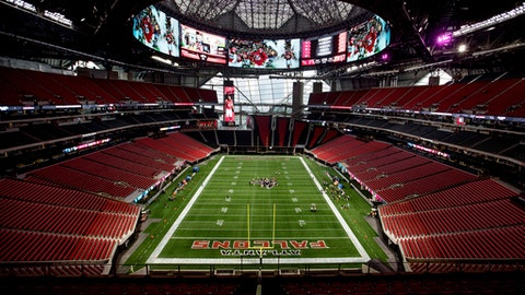 FILE - In this Aug. 15, 2017, file photo, Mercedes-Benz Stadium, the new home of the Atlanta Falcons football team and the Atlanta United soccer team, stands in Atlanta.  The Falcons' first home preseason game on Saturday against Arizona will be one to remember as it will be the first game played at the facility. The halo board is 58 feet tall and 1,100 feet around, totaling more than 62,000 square feet. The Falcons say it is the largest video board in sports. (AP Photo/David Goldman, File)