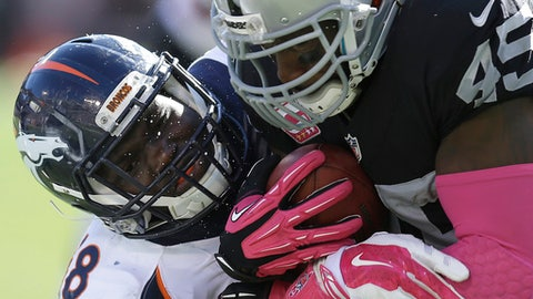 FILE - In this Oct. 11, 2015, file photo, Denver Broncos linebacker Shaquil Barrett, left, tackles Oakland Raiders fullback Marcel Reece (45) during the second half of an NFL football game in Oakland, Calif. Barrett will provide a much-needed boost to the Broncos' defensive front with his return from a hip injury. Barrett had been sidelined since getting hurt while working out on his own this spring. The Broncos have been hit hard by injuries on defense this summer. (AP Photo/Ben Margot, File)