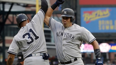 New York Yankees' Gary Sanchez, right, is congratulated by Aaron Hicks (31) after they scored on Sanchez's two-run home run during the first inning of a baseball game against the Detroit Tigers, Tuesday, Aug. 22, 2017, in Detroit. (AP Photo/Carlos Osorio)