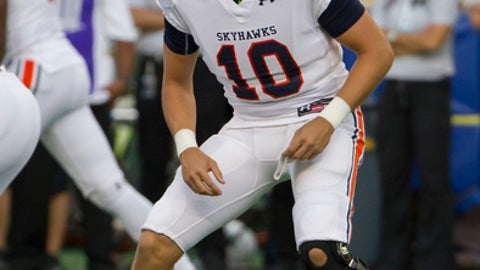 Tennessee-Martin quarterback Troy Cook (10) looks over to the sidelines before running the play in the first quarter of an NCAA college football game against Hawaii, Saturday, Sept. 10, 2016, in Honolulu. (AP Photo/Eugene Tanner)