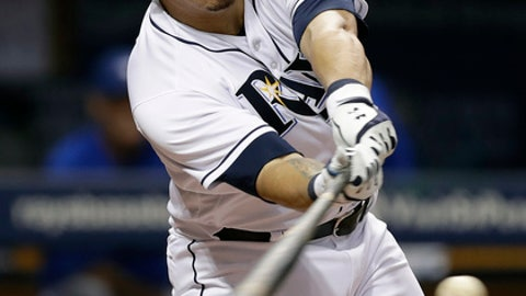 Tampa Bay Rays' Wilson Ramos connects for an RBI single off Toronto Blue Jays relief pitcher Matt Dermody during the fifth inning of a baseball game Tuesday, Aug. 22, 2017, in St. Petersburg, Fla. Rays' Evan Longoria scored. (AP Photo/Chris O'Meara)