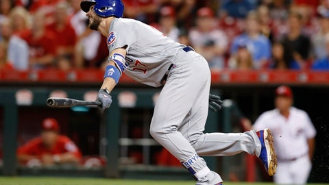 Chicago Cubs' Kris Bryant watches an RBI sacrifice fly off Cincinnati Reds relief pitcher Kevin Shackelford during the fifth inning of a baseball game, Tuesday, Aug. 22, 2017, in Cincinnati. (AP Photo/John Minchillo)