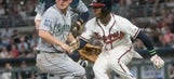 Sims sharp, Braves score on crazy play, beat Mariners 4-0