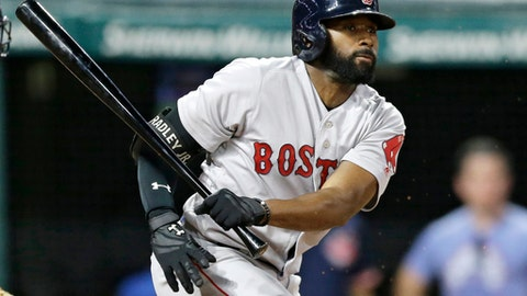Boston Red Sox's Jackie Bradley Jr. hits a single off Cleveland Indians starting pitcher Carlos Carrasco in the seventh inning of a baseball game, Tuesday, Aug. 22, 2017, in Cleveland. (AP Photo/Tony Dejak)