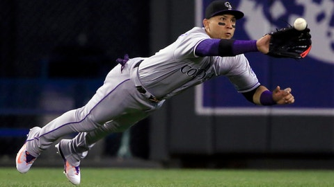Colorado Rockies right fielder Carlos Gonzalez catches a fly ball hit by Kansas City Royals' Whit Merrifield during the seventh inning of a baseball game at Kauffman Stadium in Kansas City, Mo., Tuesday, Aug. 22, 2017. (AP Photo/Orlin Wagner)