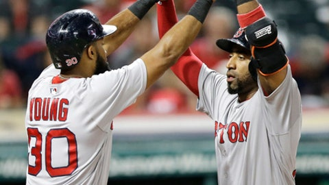 Boston Red Sox's Eduardo Nunez, right, is congratulated by Chris Young after Nunez hit a three-run home run off Cleveland Indians relief pitcher Shawn Armstrong in the eighth inning of a baseball game, Tuesday, Aug. 22, 2017, in Cleveland. Sandy Leon and Chris Young scored on the play. (AP Photo/Tony Dejak)