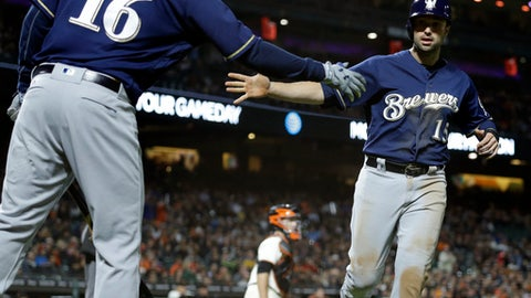 Milwaukee Brewers' Neil Walker, right, is congratulated by Domingo Santana (16) after scoring against the San Francisco Giants during the seventh inning of a baseball game Tuesday, Aug. 22, 2017, in San Francisco. (AP Photo/Ben Margot)