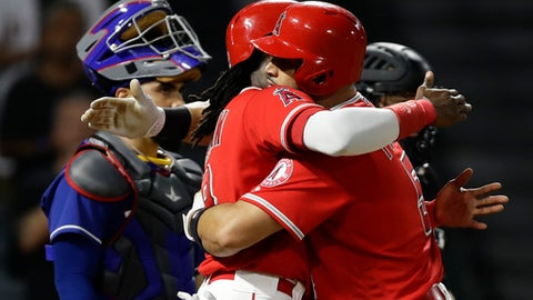 Los Angeles Angels' Albert Pujols, right, celebrates his three-run home run with Cameron Maybin during the seventh inning against the Texas Rangers in a baseball game in Anaheim, Calif., Tuesday, Aug. 22, 2017. (AP Photo/Chris Carlson)
