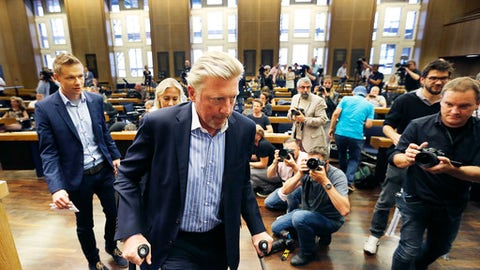 German tennis legend Boris Becker arrives on crutches after an ankle surgery some weeks ago,  to attend a news conference seeking about his new role in the German Tennis Federation in the town hall in Frankfurt, Germany, Wednesday, Aug. 23, 2017. As 'Head of Tennis'  Becker now is responsible for the men's tennis of the German Tennis Federation.  (AP Photo/Michael Probst)